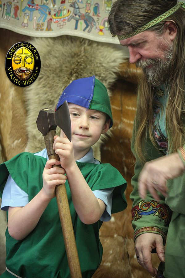 School child asking a question about a Viking axe - Part of an classroom presentation by Lore and Saga - Image copyrighted © Gary Waidson. All rights reserved.